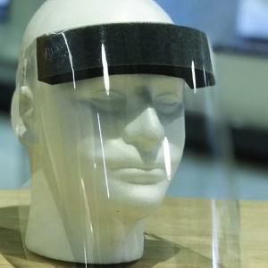Clear plastic face shield with elastic strap